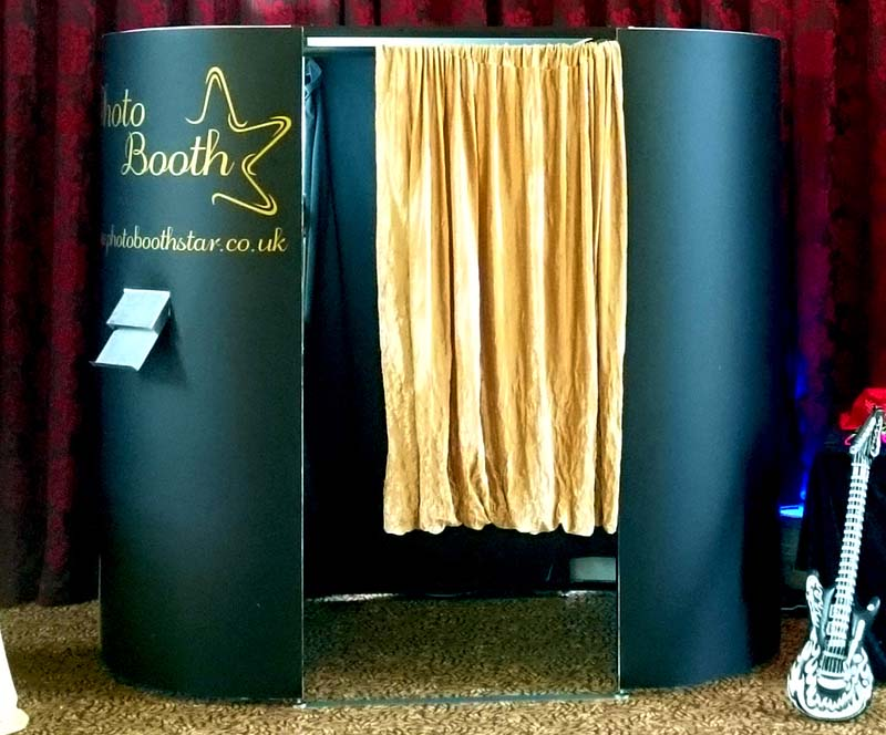 oval gold enclosed photo booth in the UK