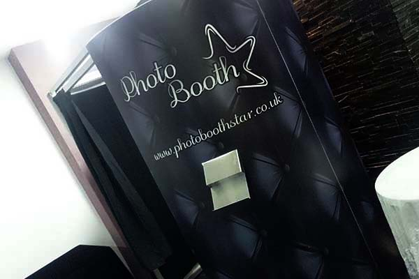 enclosed black photo booth